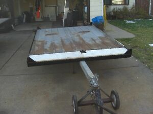 5 FT.8-IN  WIDE X 9 FT LONG TILT DECK SLED TRAILER