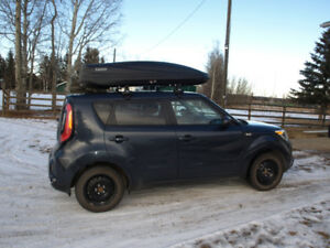 2014 Kia Soul with roof rack and carrier