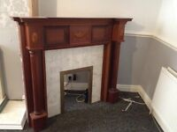 Wooden fireplace and back panel