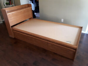 Bed with headboard drawers