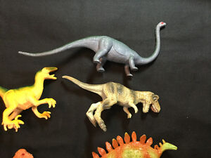 7 Assorted Plastic Realister Toy Dinosaur Play Set.      $15.00