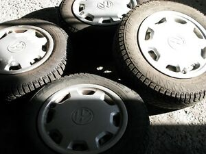 4 Pirelli Winter Carving 185/65R14 on steel rims w/wheel covers West Island Greater Montréal image 8