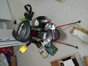 Golf clubs with lots of accessories