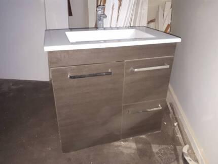 Bathroom vanity plus sink looking for a new home