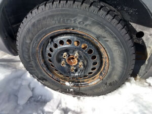 """Hankook 15"""" Ipike winter tires on steel rims 215/70R15"""