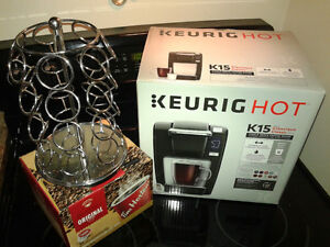 New Keurig coffee maker, K Cup rack and box of Timmies K Cups
