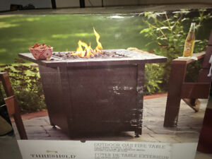 Outdoor gas fire table in box