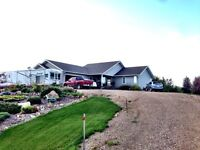 Beautiful Bungalow on 5 Acres (Sask Side)