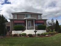 Spacious Beautiful brick home on 10+ Acres!
