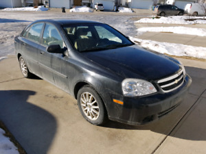 Only 96000kms. 2004 Chevy Optra