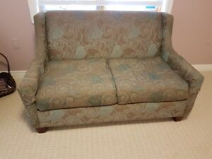 Beautiful brown and teal love seat