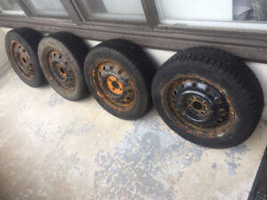4 Used Winter Tires With Rims Included