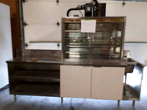 Refrigerated counter with new compressor