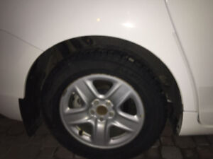 Rims and michlein winter tires barely used  with original toyota