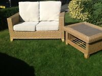 Rattan two seater sofa and table