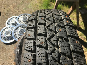 Set of studded Arctic Claw Winter TXI tires 195/70/14