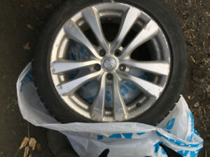 Infiniti original magnesium rims and witer tires (4 tires)