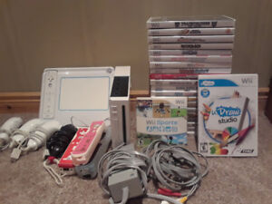 Wii system including Udraw and Wii Fitness board PLUS 20 games