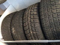 WINTER TIRES ON RIMS  four (4) sets of  215/50R17 Bridgstone Bli