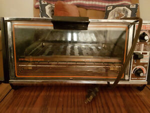 GE Toaster Oven and Toastess press
