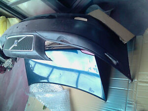 Volvo S80 front bumper cover with grill and moulding black color
