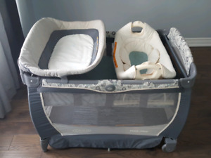 Graco Pack n Play With Cuddle Cove Rocking Seat Play Yard