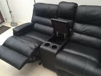 2 seater rocker recliner with central storage box and drinks holder