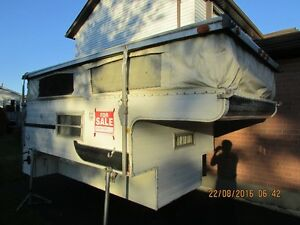 Pop up truck camper for sale