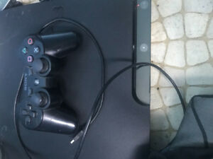 PS3, one remote/charger with games