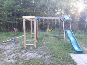 Swing Set and monkey bars and teeder totter.