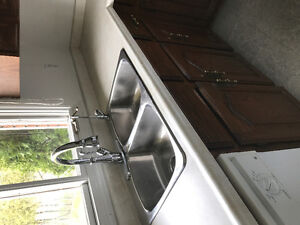Stainless steel sink and brand new chrome pull down faucet