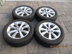 Bridgestone P195/55R16 with rims