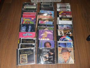 Cassettes VHS ou CD musiques 1$ ch.   450-994-2242