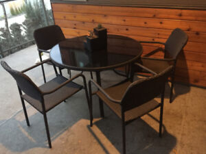 Patio set with round table, four chairs