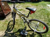 Bicycle  SR SUNTOUR  24'' pour garçon 65$