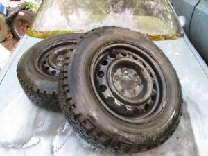 205/65/R15 Mounted/Balanced Studded Snow Tires. Grand Am