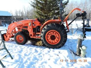 Kubota 4701 tractor and 20 foot flat deck trailer for sale