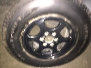 6 bolt chevy rim with brand new 16 inch tire