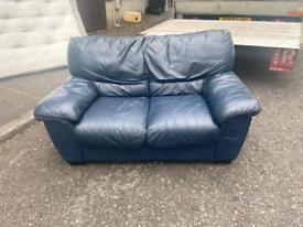11. Blue leather 2 seater sofa
