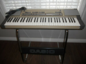 Casiotone 610 synthesizer in metal with stand and power cord