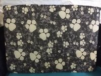 Medium dog bed. Black and white paws