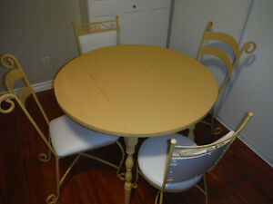 Solid wood table with Wrought Iron Chairs
