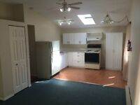 Ground level 1 bedroom suite with den in Whiskey Creek.
