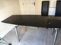 Black glass extendable dinning room table