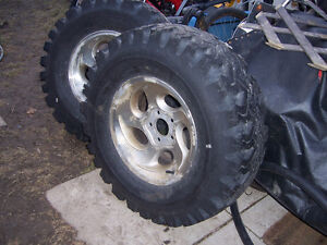 4 TIRES 2 MUD SNOW 2 WEEKS OLD 2  FRONT DECENT15IN15IN
