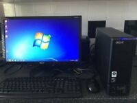 "Acer Aspire Windows 7 compact desktop PC quad core processor complete with 22"" Monitor."