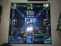 BRAND NEW CSI BOARD GAME WAS NEVER PLAYED AND STUFF IS  SEALED!!