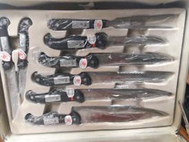Chef Kitchen set of utensils in case.