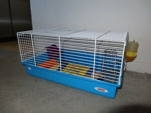 Cage for small rodents with food and accessories