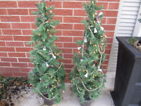 "2 - Christmas Trees with cement urns- 45"" tall"